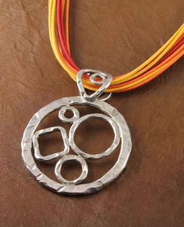 Hammered_Silver_Pendant_on_Ochre_Ties_N-0107-a